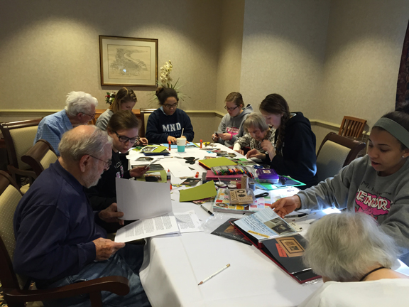 parnters and students working on scrapbooks